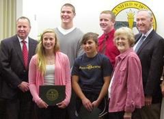 district recognizes four stellar student athletes